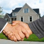 Why use an estate agent to sell your property - shaking hands